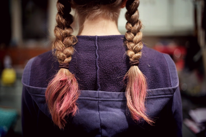 Girl with pink plaited hair.