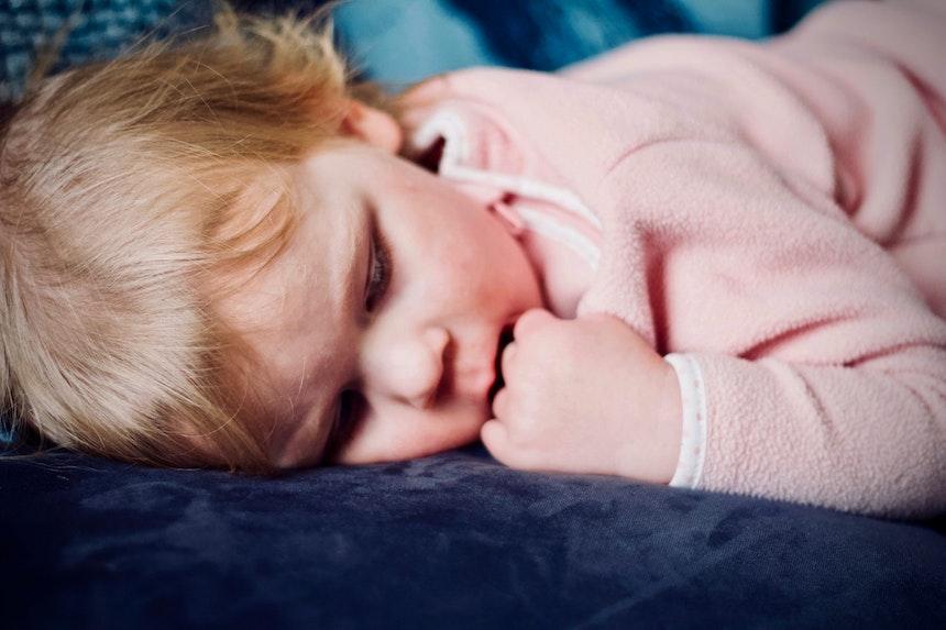Baby asleep on her side