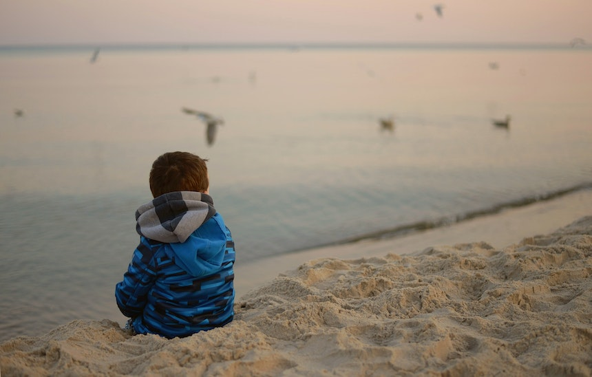 Child sitting on a beach