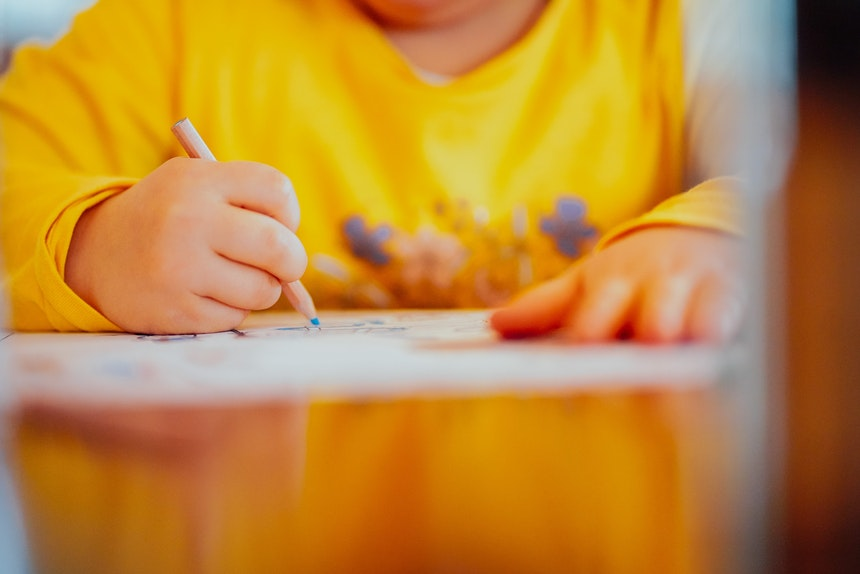 Boy colouring on a page