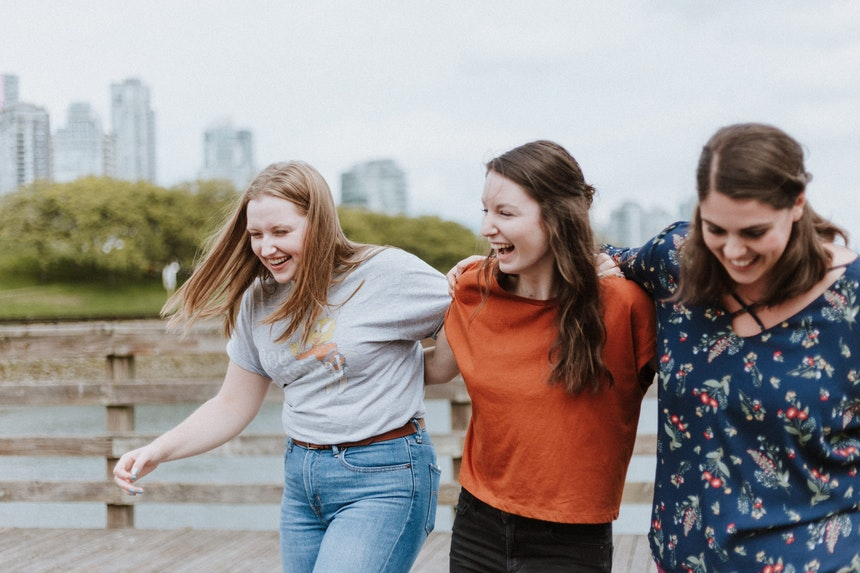 Girls walking and laughing together.