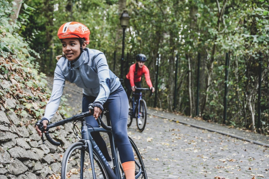 People cycling in a forest.