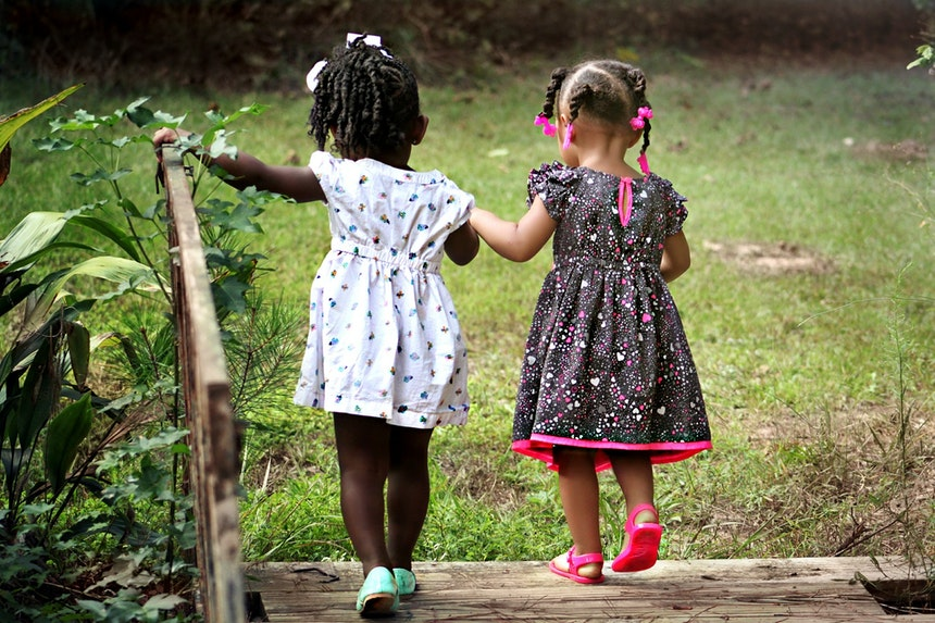 Two girls walking together outside