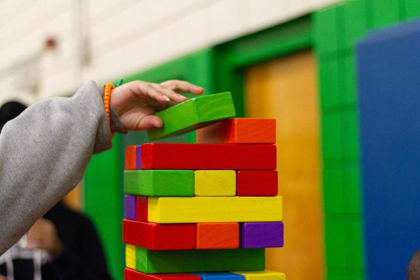 Child stacking blocks