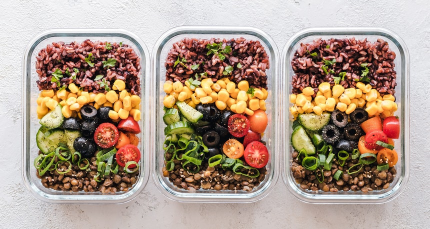 Three packed lunches with vegetables and beans