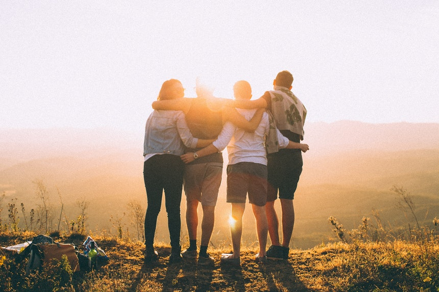 Group of friends hugging.
