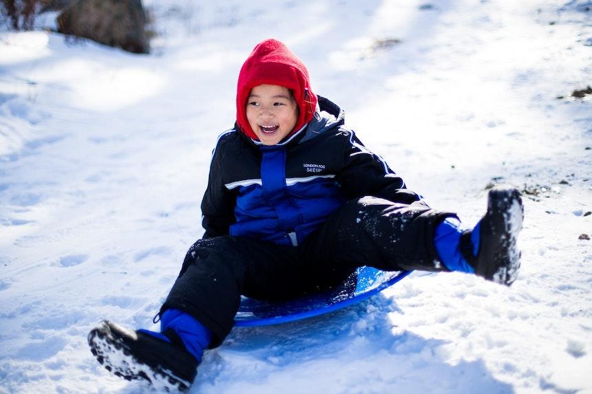 Boy on bob sled