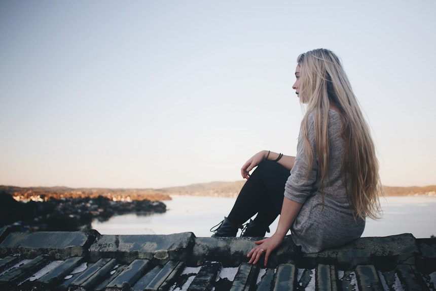 Girl sitting alone.
