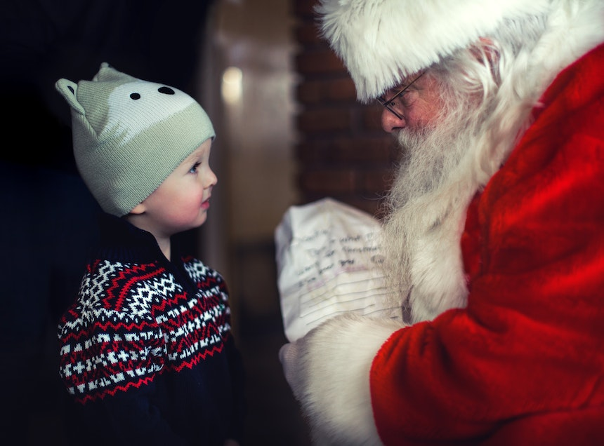 Little boy meeting Santa