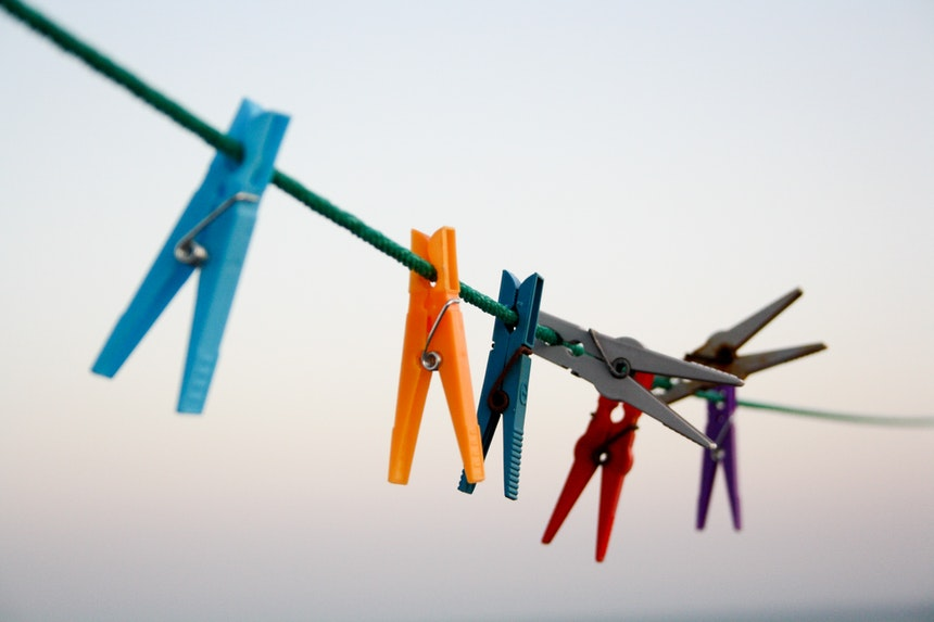 Clothes pegs hanging on a line