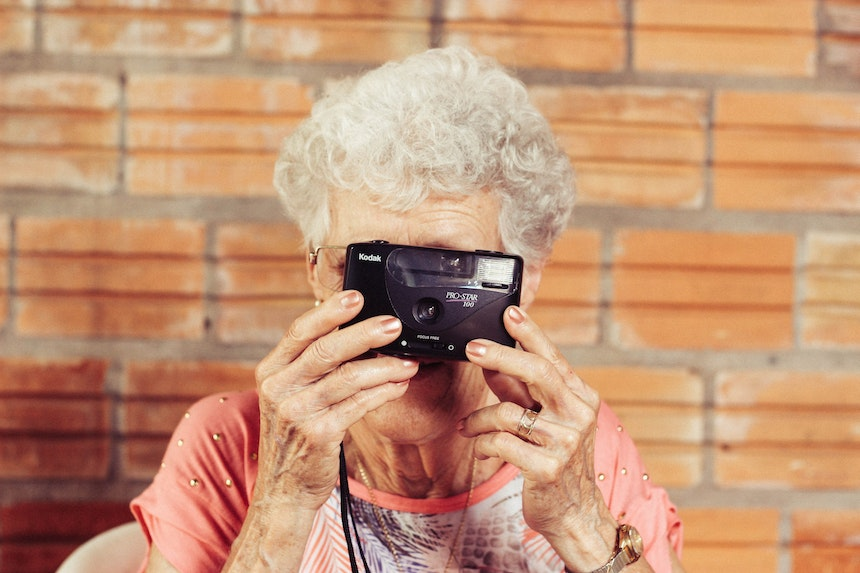 Elderly woman holding a camera