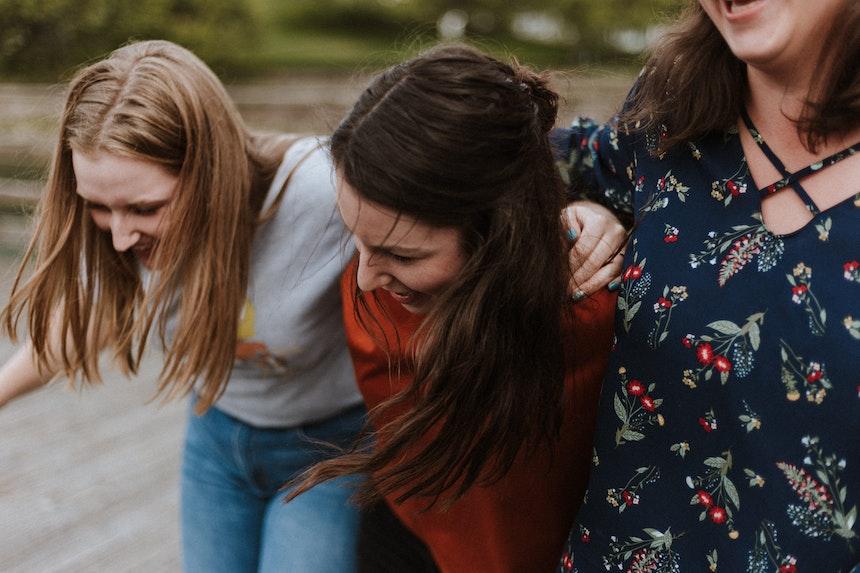Girls laughing and hugging