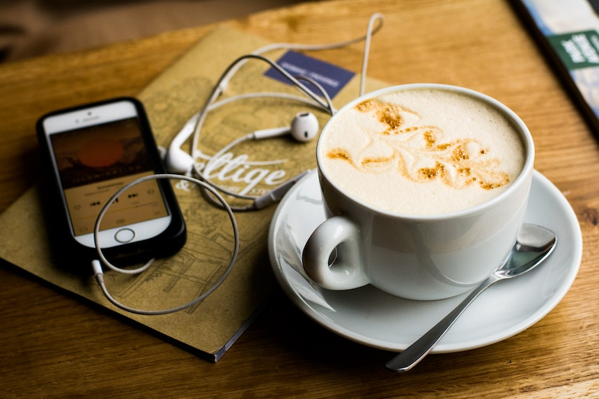 Coffee cup and earphones